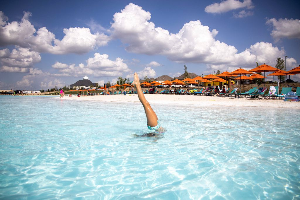 Alexis Domin performs a handstand in the water at the Crystal Lagoon.