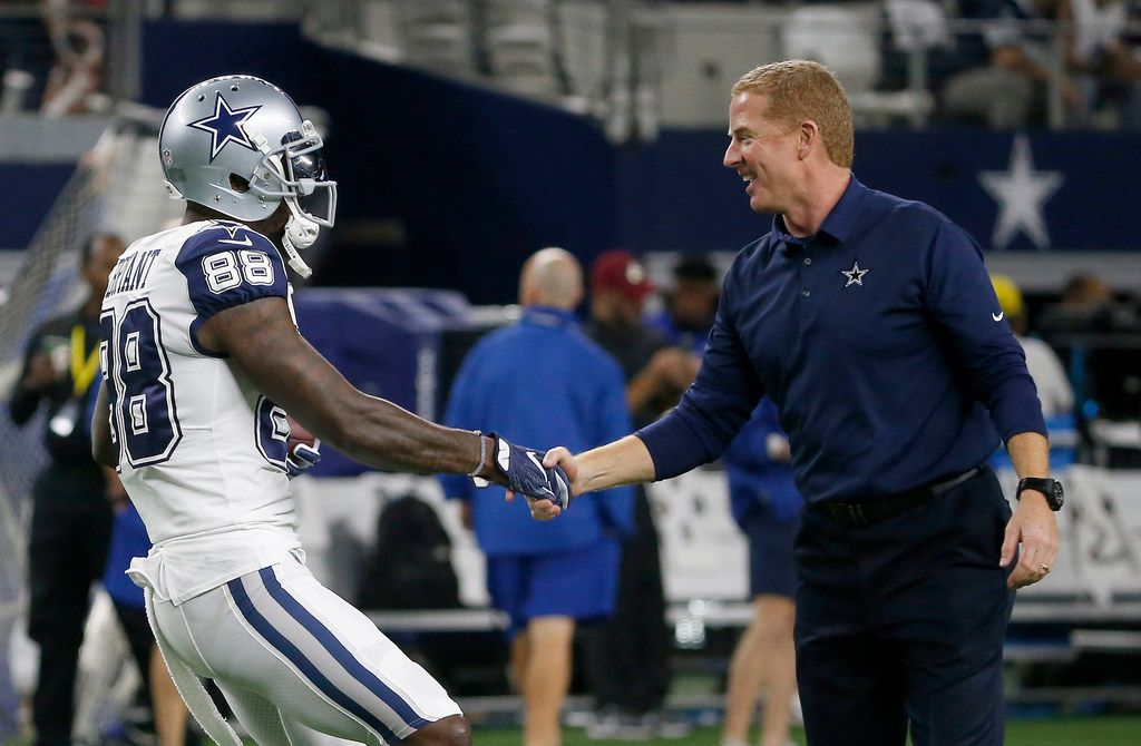 Dallas Cowboys head coach Jason Garrett (right) shakes hands with wide receiver Dez Bryant (88) during the warm-up prior to the Thursday Night game against  Washington Redskins at AT&T Stadium in Arlington, Texas, Thursday, Nov. 30, 2017. (Jae S. Lee/The Dallas Morning News)