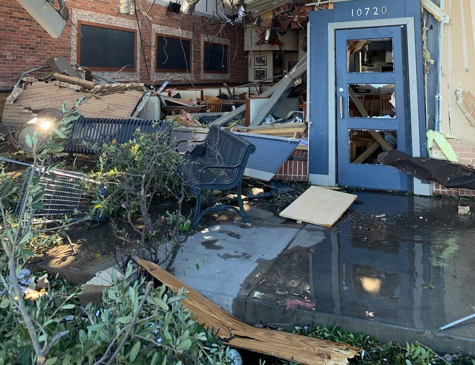 Celebrity Health: The area to the left of the front door shows the demolished restaurant Fish City Grill. Co-owner Bill Bayne plans to reopen the restaurant. Many of the shops at the southeast corner of Preston Road and Royal Lane were hit by the tornado.