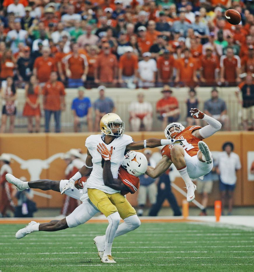 Texas cornerback Sheroid Evans (29) and safety DeShon Elliott (4) break up a pass intended for Notre Dame wide receiver Equanimeous St. Brown (6) in the first quarter during the Notre Dame Fighting Irish vs. the University of Texas Longhorns NCAA football game at Darrell K. Royal Memorial Stadium in Austin on Sunday, September 4, 2016. (Louis DeLuca/The Dallas Morning News)