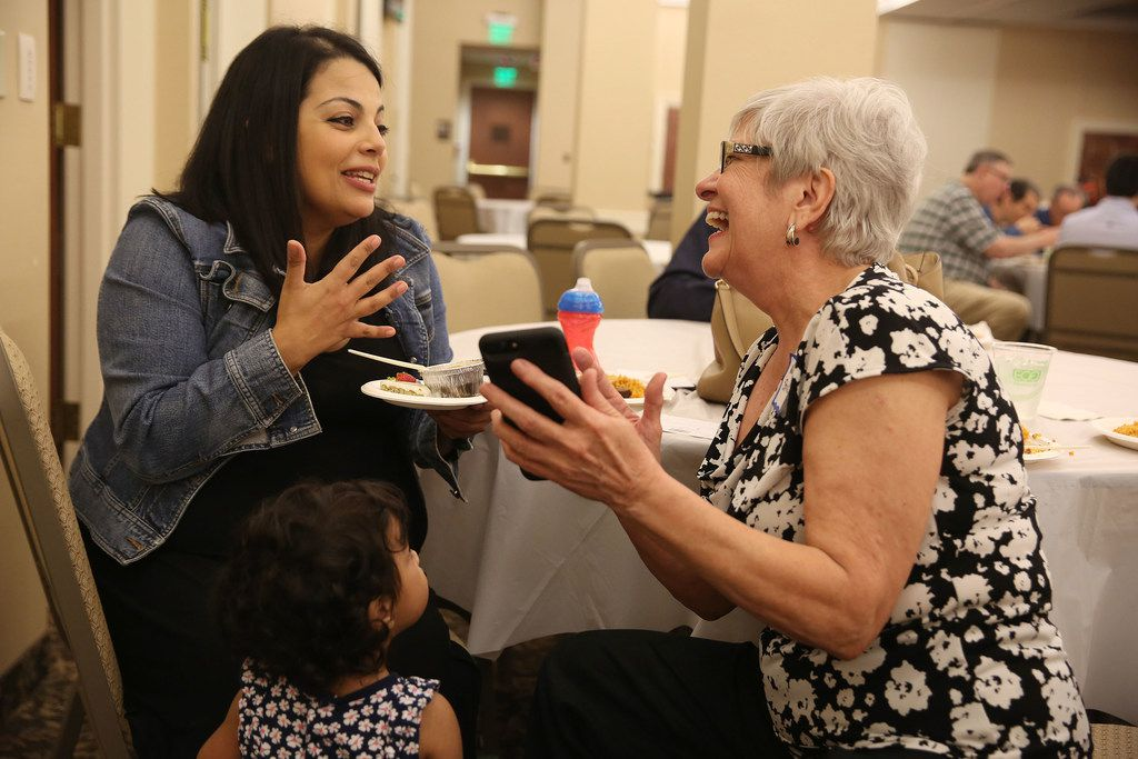Aysha Omar (left) speaks with Nancy Stretch while feeding her daughter Dina Omar, 1, during an interfaith Ramadan dinner with members of the Dialogue Institute and Wilshire Baptist Church at the church in Dallas on Thursday, June 7. Guests broke the Ramadan fast after Emrah Aktepe, who is director of the Dialogue Institute Dallas, explained Ramadan.