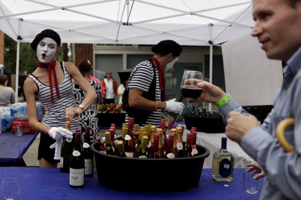 Robyn Pinilla, left, and David Pinilla, center, serve wine to Jeff Chesnut, right, during Bastille on Bishop on July 14, 2013 on Bishop Ave. in Dallas.