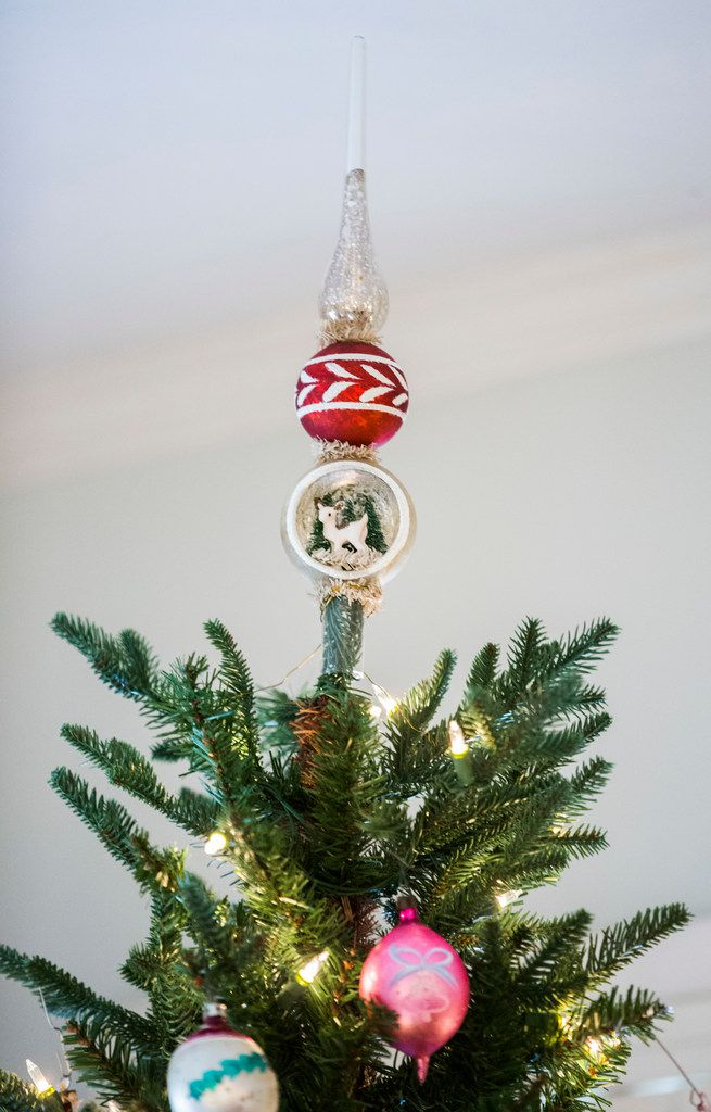 A collection of vintage Christmas ornaments and decorations