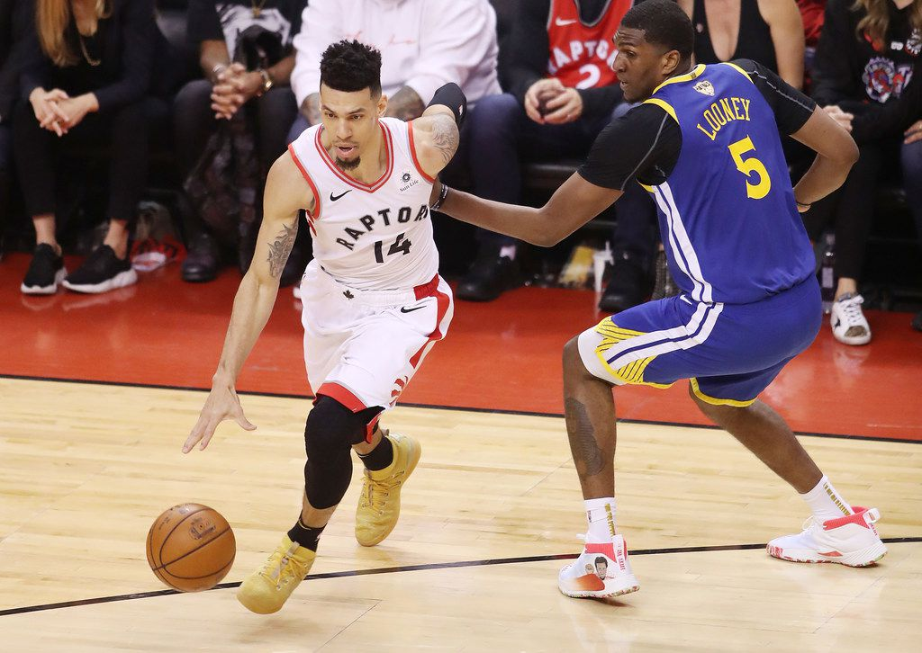 TORONTO, ONTARIO - JUNE 10:  Danny Green #14 of the Toronto Raptors is defended by Kevon Looney #5 of the Golden State Warriors in the first half during Game Five of the 2019 NBA Finals at Scotiabank Arena on June 10, 2019 in Toronto, Canada. (Photo by Claus Andersen/Getty Images)