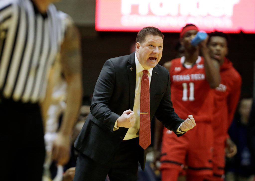 Texas Tech head coach Chris Beard yells instructions to his players during the first half of an NCAA college basketball game against West Virginia Wednesday, Jan. 2, 2019, in Morgantown, W.Va. (AP Photo/Raymond Thompson)