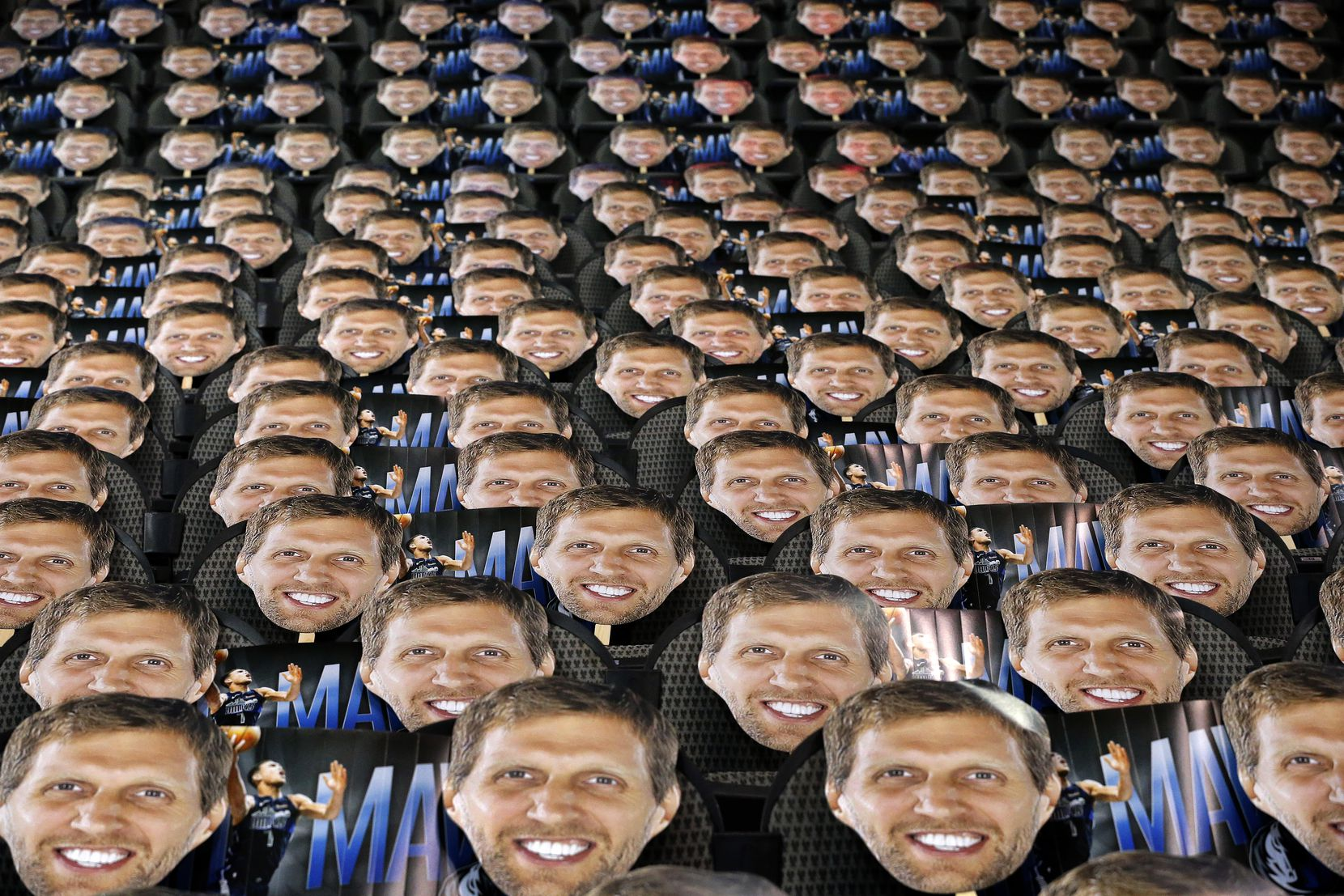 The Dallas Mavericks placed cutouts of Dirk Nowitzk's face on each seat behind both baskets at the American Airlines Center in Dallas on April 5. The team passed them out to be used as a distraction to opposing players shooting free throws.