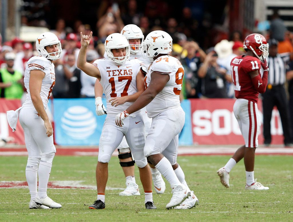 Texas Longhorns place kicker Cameron Dicker (17) celebrates with Texas Longhorns punter Ryan Bujcevski (8) and Texas Longhorns defensive lineman Gerald Wilbon (94) after Dicker kicked the game winning field goal during the second half of play at the Cotton Bowl in Dallas on Saturday, October 6, 2018. Texas Longhorns defeated Oklahoma Sooners 48-45. (Vernon Bryant/The Dallas Morning News)