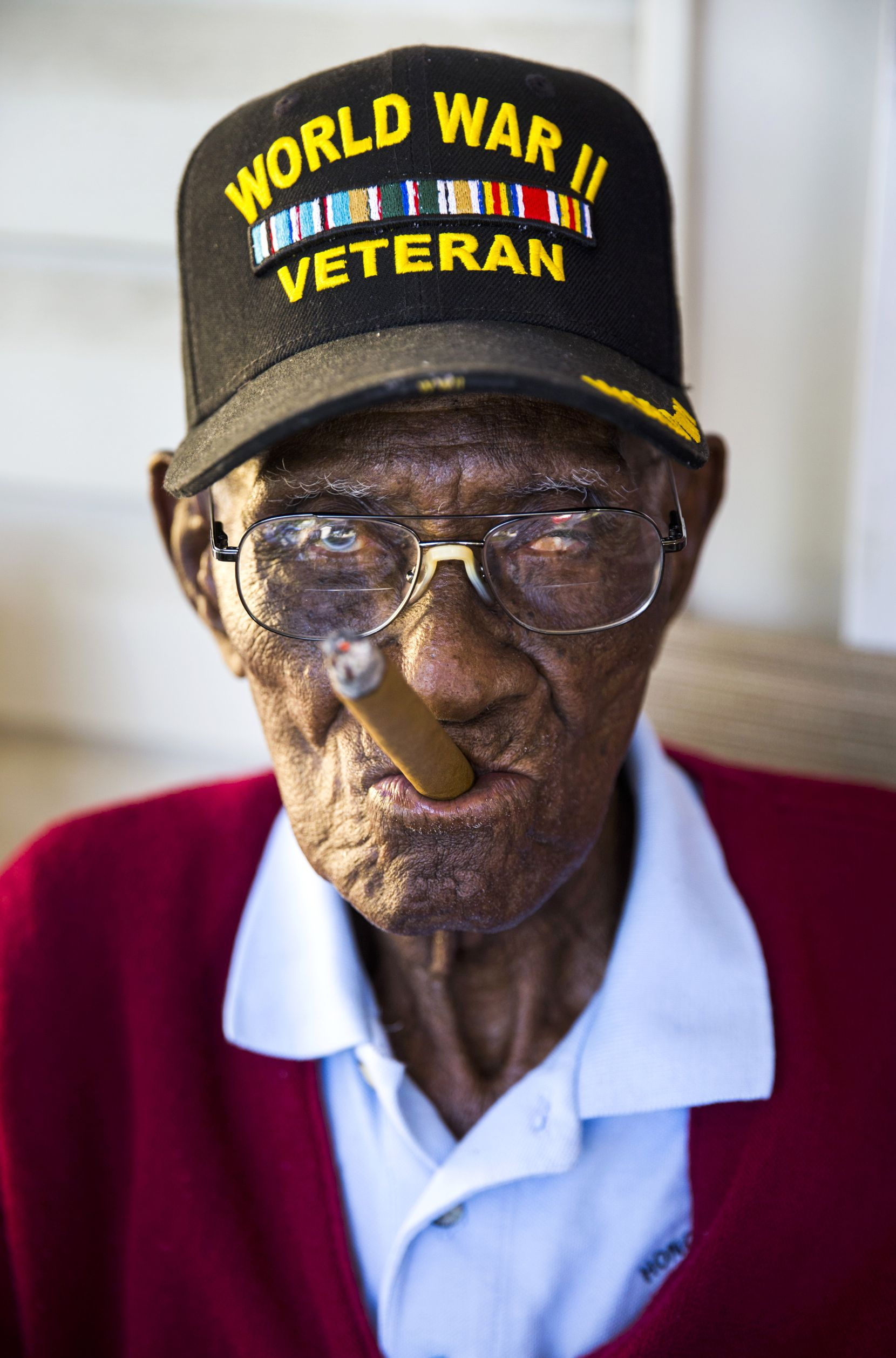Richard Overton, 111, the oldest living U.S. war veteran, smokes a cigar on his front porch in Austin. Overton is known for puffing on a cigar and drinking whiskey while spending hours on his porch on nice days.Ashley Landis