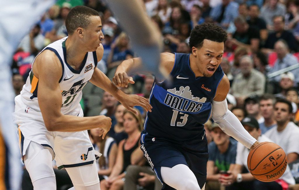 Dallas Mavericks guard Jalen Brunson (13) drives past Utah Jazz guard Dante Exum (11) during the second half a game between the Dallas Mavericks and the Utah Jazz at the American Airlines Center in Dallas, Sunday, October 28, 2018. (Ryan Michalesko/The Dallas Morning News)