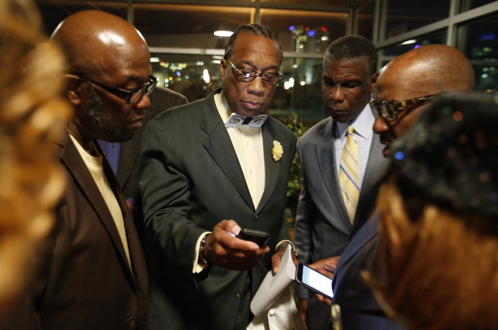 John Garrett (from left), veteran Democratic incumbent John Wiley Price (running for Dallas County commissioner), Zachary Thompson and Vincent Hall looked over results during an election night party on March 1, 2016