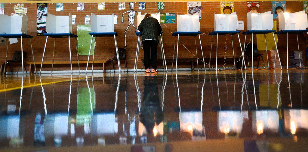 A woman votes at Precinct 4069 in Winnetka Elementary School in Dallas on Nov. 8, 2016.