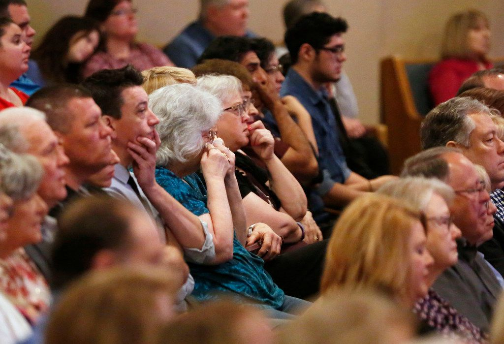 Worshippers listen to Tralissa Griffin talks about losing her daughter in the 1999 shootings.