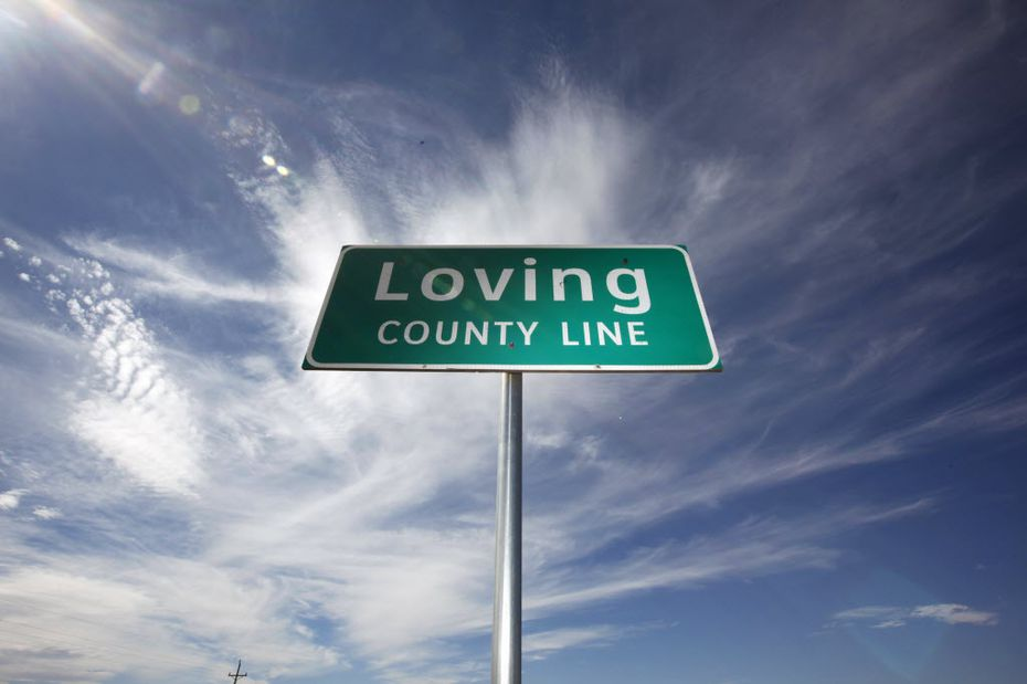 FILE photo shows the county line sign at the eastern line of Loving county on Texas Highway 302. (Sonya N. Hebert/The Dallas Morning News)