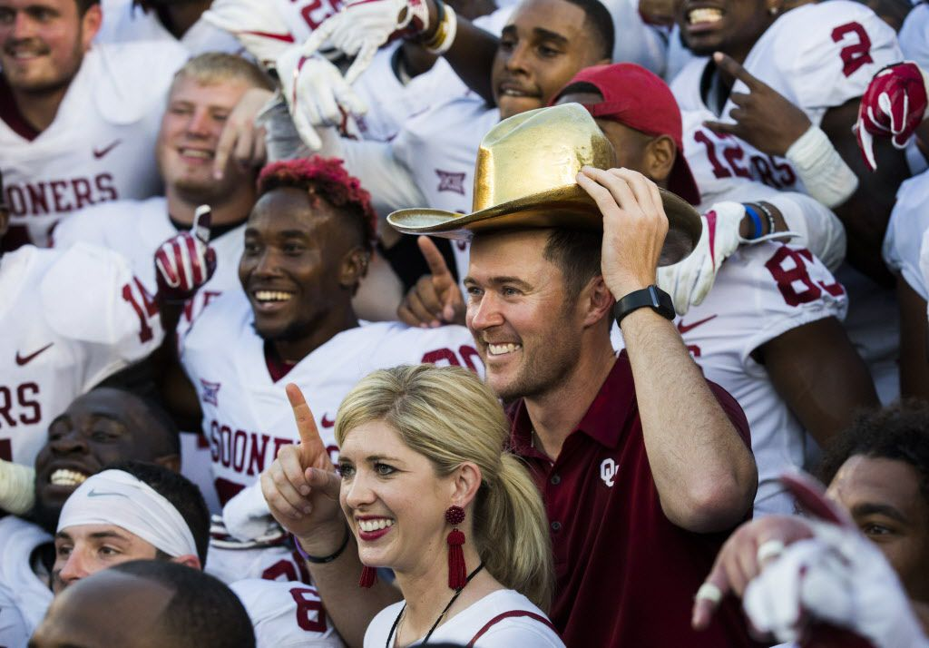 Oklahoma Sooners head coach Lincoln Riley wears the golden hat trophy while posing for a team photo after a 29-24 win over the Texas Longhorns at the AT&T Red River Showdown college football game between the University of Texas and Oklahoma University on Saturday, October 14, 2017 at the Cotton Bowl in Fair Park in Dallas. (Ashley Landis/The Dallas Morning News)