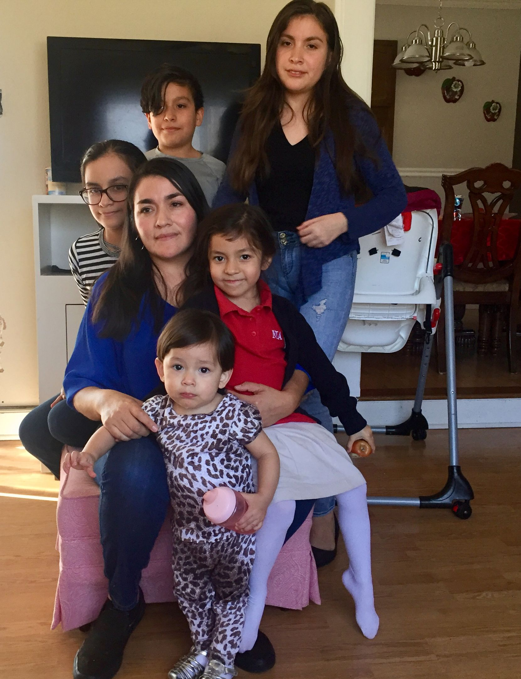 Lucia Mejia and her children await the outcome of Adolfo Mejia's deportation case. The children are U.S. citizens, and the mother is a legal resident.