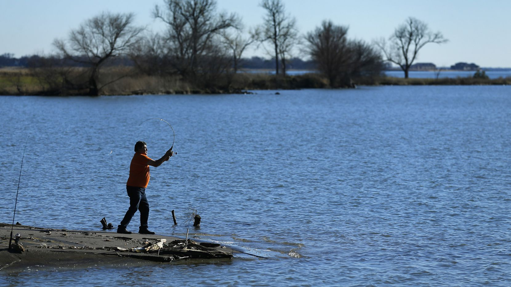 Fisherman Jose J Torres of Dallas cast his line near the Bayside development under construction on the Lake Ray Hubbard peninsula south of Interstate 30 in Rowlett, Texas, Friday, January 4, 2019. Mayor Tammy Dana-Bashian spoke of the city's lawsuit filed against Bayside Land Partners LLC and Bayside District Partners LLC over what they say is a default in development agreements after months of unsuccessful discussions about the 262-acre Bayside development, which includes Crystal Lagoon.