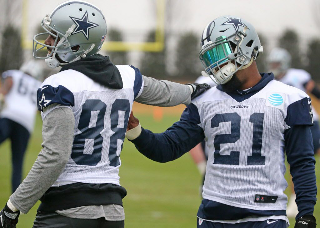 Dallas Cowboys wide receiver Dez Bryant (88) talks with running back Ezekiel Elliott (21) as they stretch together at practice at the Star in Frisco, Texas on Wednesday, December 20, 2017. (Louis DeLuca/The Dallas Morning News)