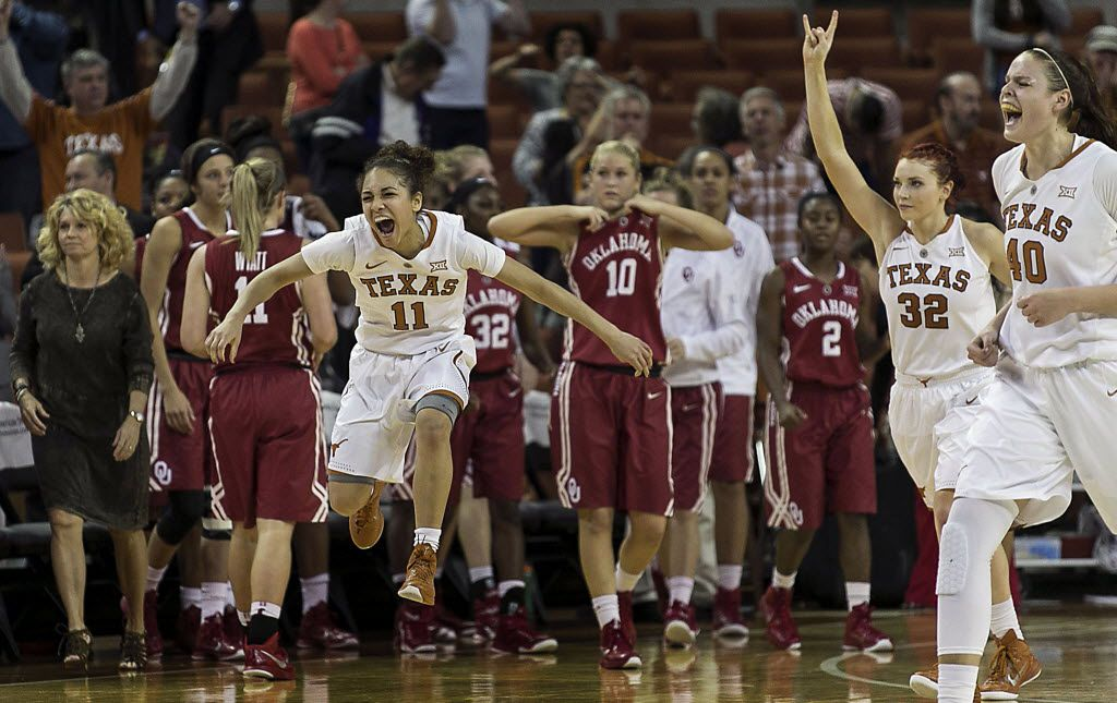 Texas Brooke McCarty (11), Brady Sanders (32) and Kelsey Lang (40) left to right, celebrate the double overtime victory over Oklahoma in NCAA basketball game on Thursday, Jan. 29, 2015, in Austin, Texas. Texas defeated Oklahoma 84-81.(AP Photo/Austin American-Statesman, Rodolfo Gonzalez) 01302015xSPORTS