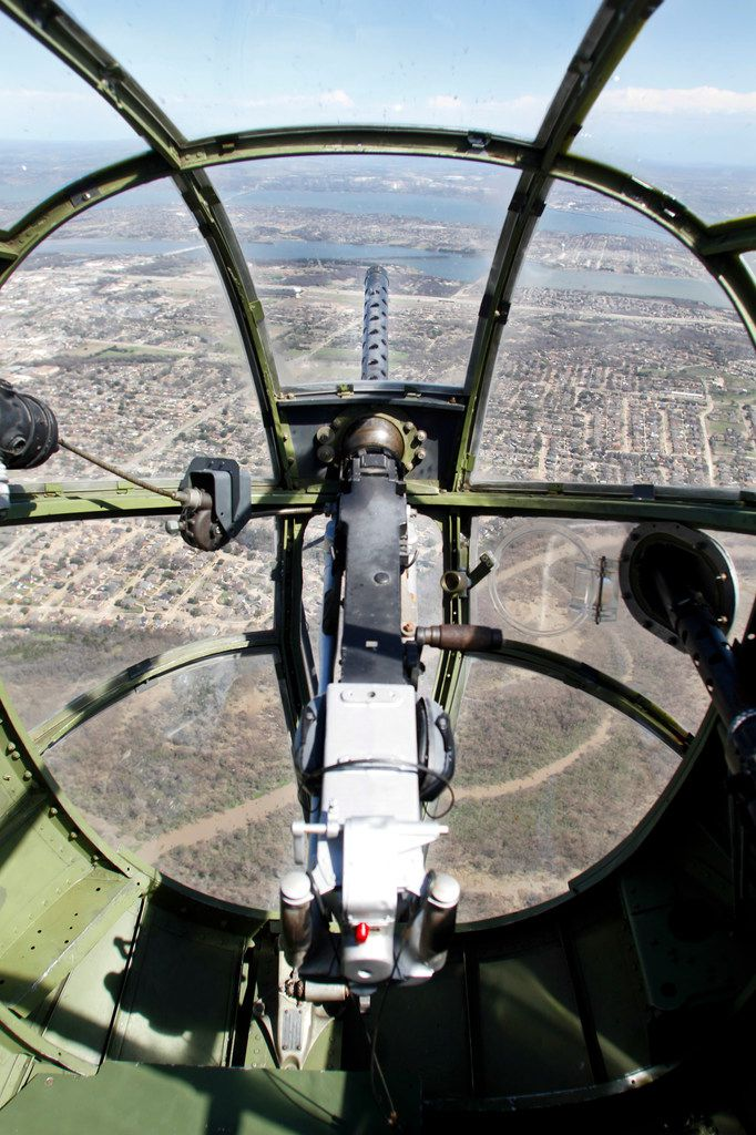 The view looking over a .30 caliber machine gun from the bombardier/navigator seat in the front nose of a North American B-25 Mitchell Bomber as the plane flies over North Texas during a media flight on Wednesday, March 13, 2019. The bomber is part of Collins Foundation's Wings of Freedom Tour at the Frontiers of Flight Museum.