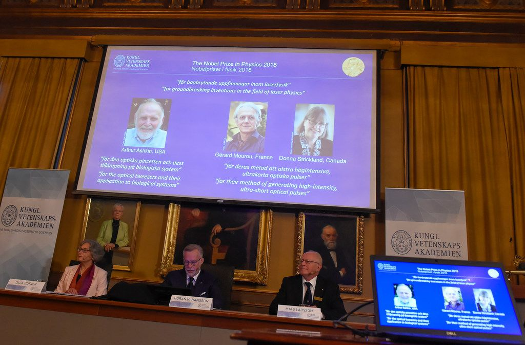 The 2018 Nobel Prize laureates for physics were shown Tuesday (from left), Arthur Ashkin of the United States, Gerard Mourou of France and Donna Strickland of Canada, during the announcement at the Royal Swedish Academy of Sciences in Stockholm, Sweden.