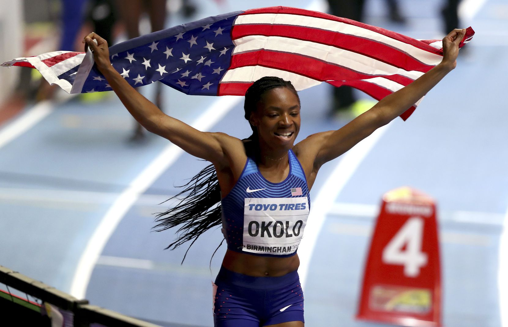 FILE - United States' Courtney Okolo celebrates winning the women's 400-meter final at the World Athletics Indoor Championships in Birmingham, Britain, Saturday, March 3, 2018. (AP Photo/Alastair Grant)