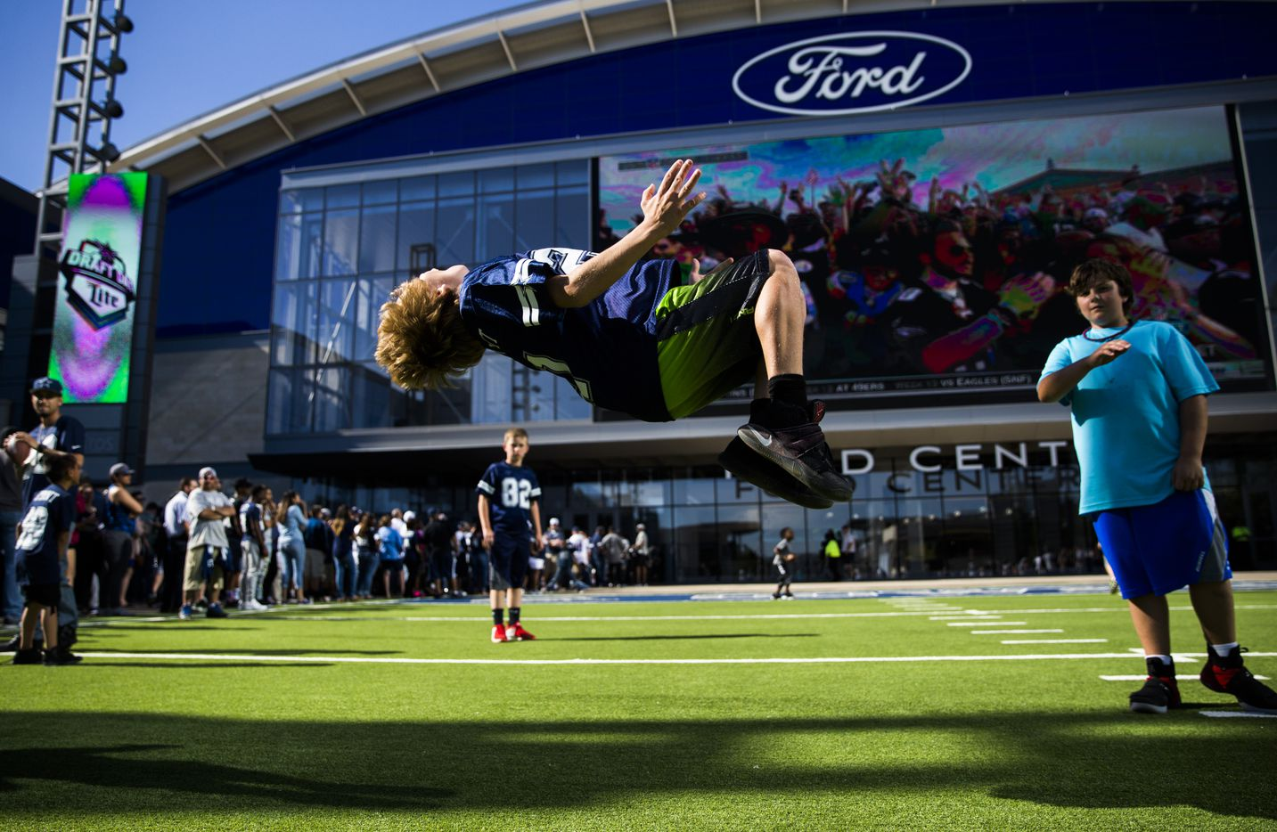 Devon Cohen, 10, does a backflip outside the Dallas Cowboys' 2017 NFL Draft Party on Thursday, April 27, 2017, at The Star in Frisco, Texas.