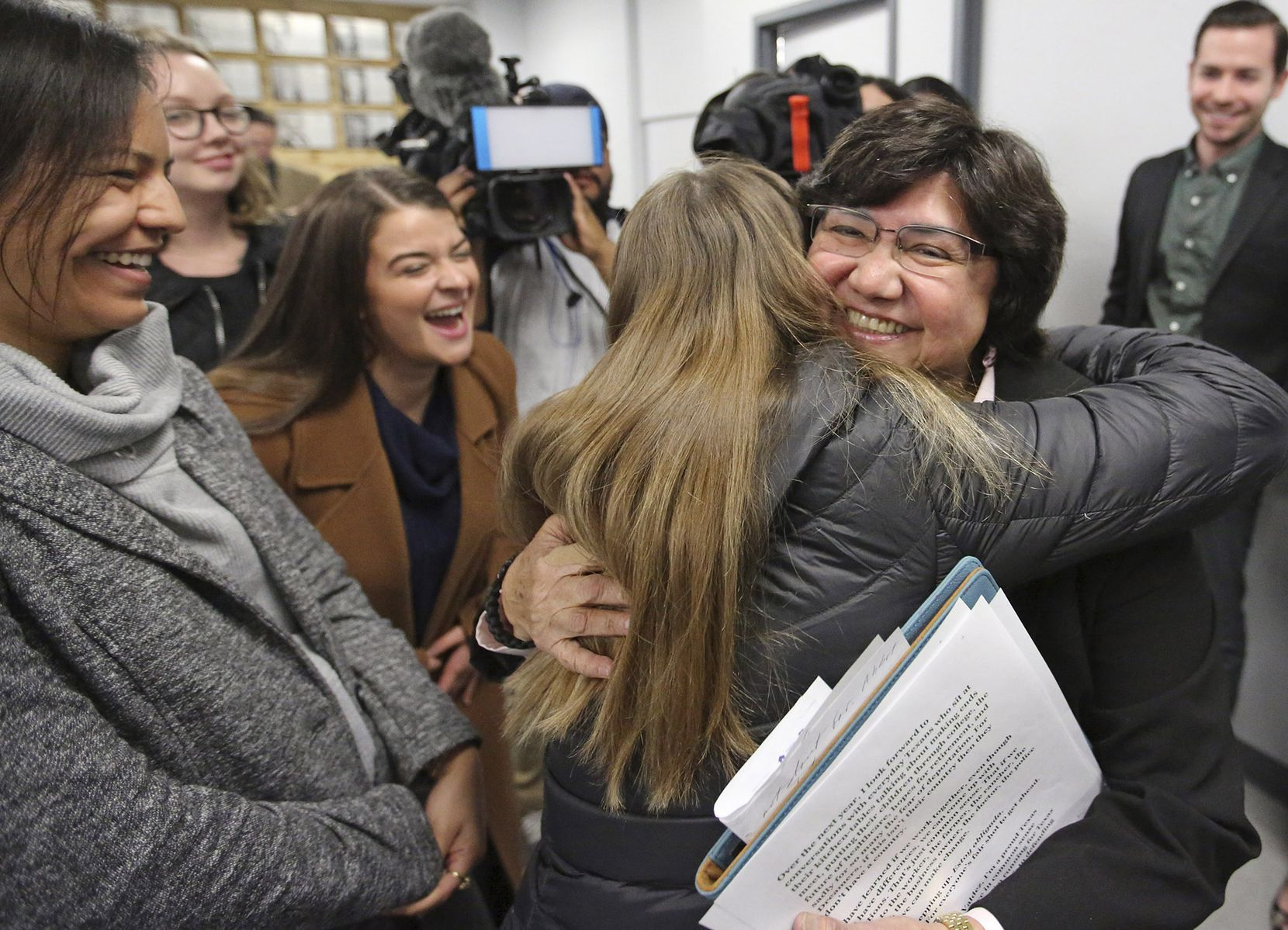 Lupe Valdez is hugged by well-wishers after her announcement that she will seek the Democratic nomination for Texas governor at a news conference in Austin.
