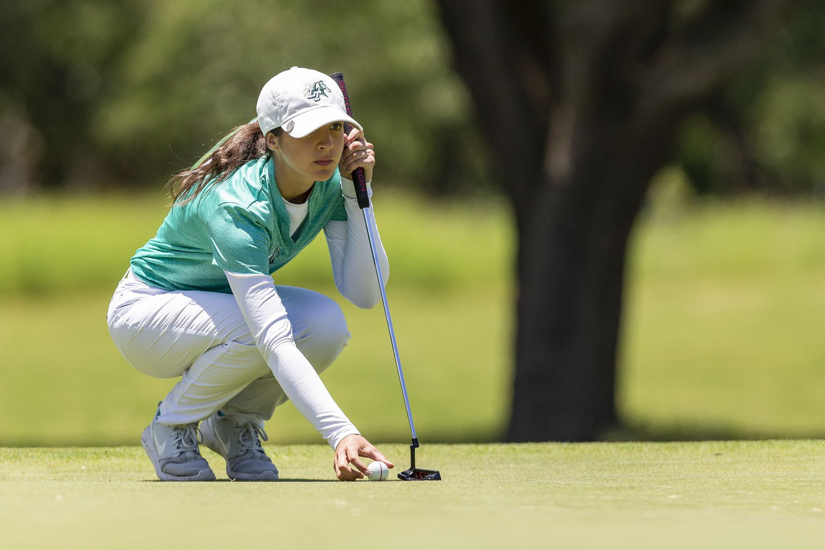 Frisco Lebanon Trail's Dominique Gomez studies her shot on the 13th green during round 1 of the UIL Class 5A girls golf tournament in Georgetown, Monday, May 13, 2019. (Stephen Spillman/Special Contributor)