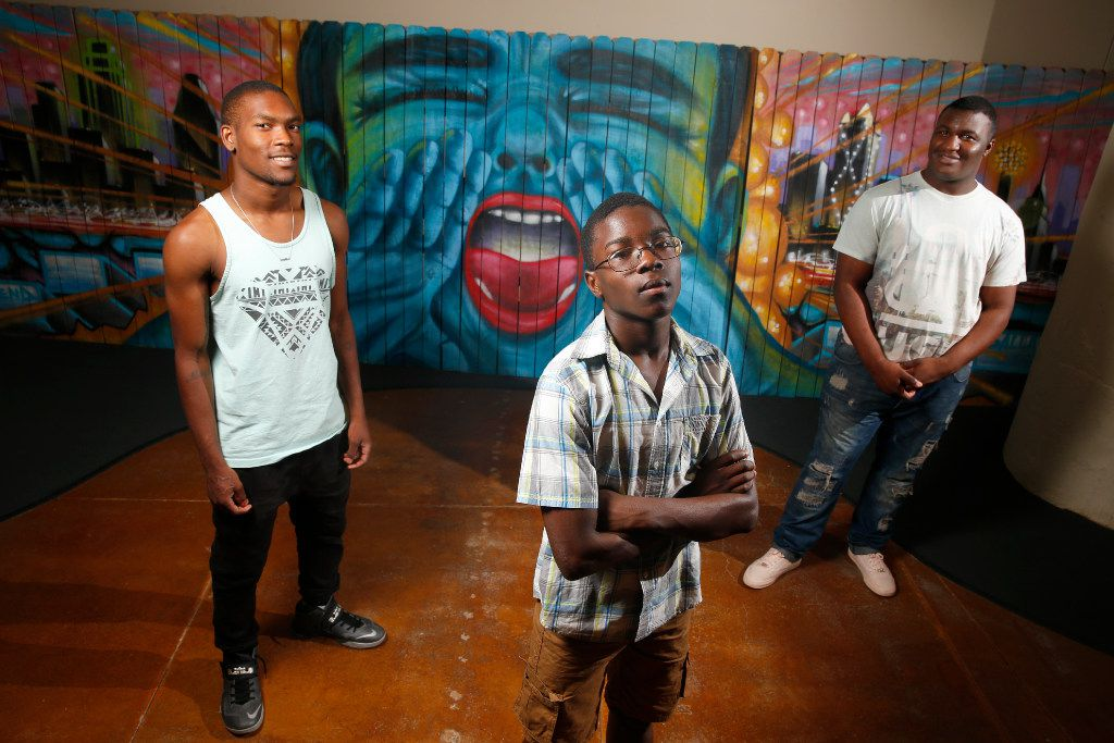 Vertiz Wood, 19, (from left) Colby Glaspie, 16, and Dejahn Carr, 18, read their poetry for a Big Thought mural in Dallas on June 16, 2017.  (Nathan Hunsinger/The Dallas Morning News)