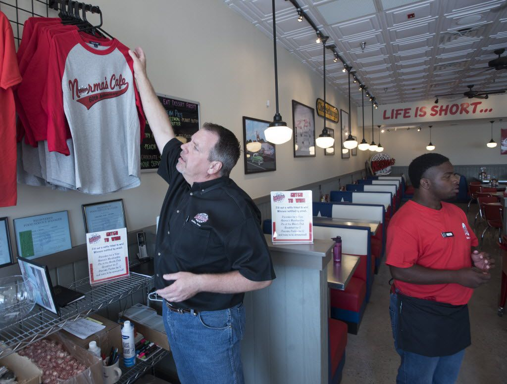 Bill Ziegler, director of operations for Norma's Cafe, hangs up a shirt at the restaurant chain's newest location of in Caruth Plaza on Friday, July 8, 2016.