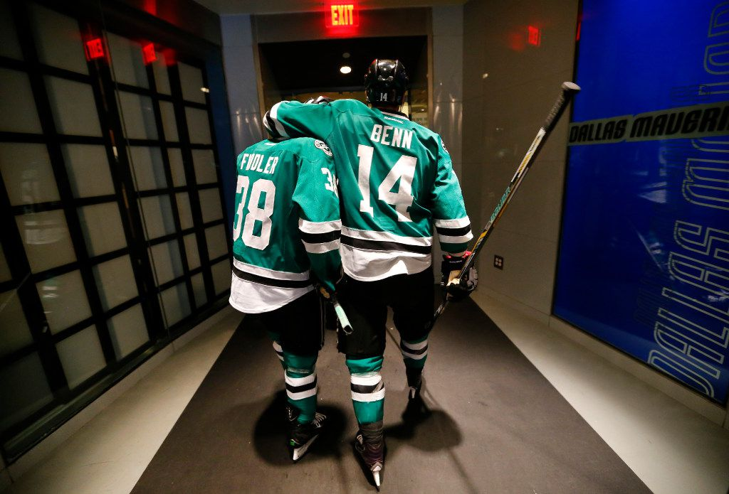 Dallas Stars left wing Jamie Benn (14) puts his arm around  teammate Vernon Fiddler (38) as they head for the exit to the locker after losing to the St. Louis Blues in Game 7 of the Western Conference semifinals at the American Airlines Center in Dallas, Wednesday, May 11, 2016. The Stars lost the game and the series. (Tom Fox/The Dallas Morning News) ORG XMIT: DMN1605112158042072