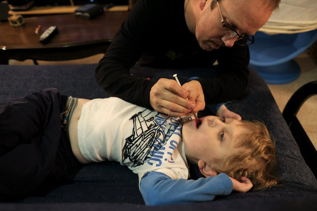 His father gives Elijah a cannabis oil extract.