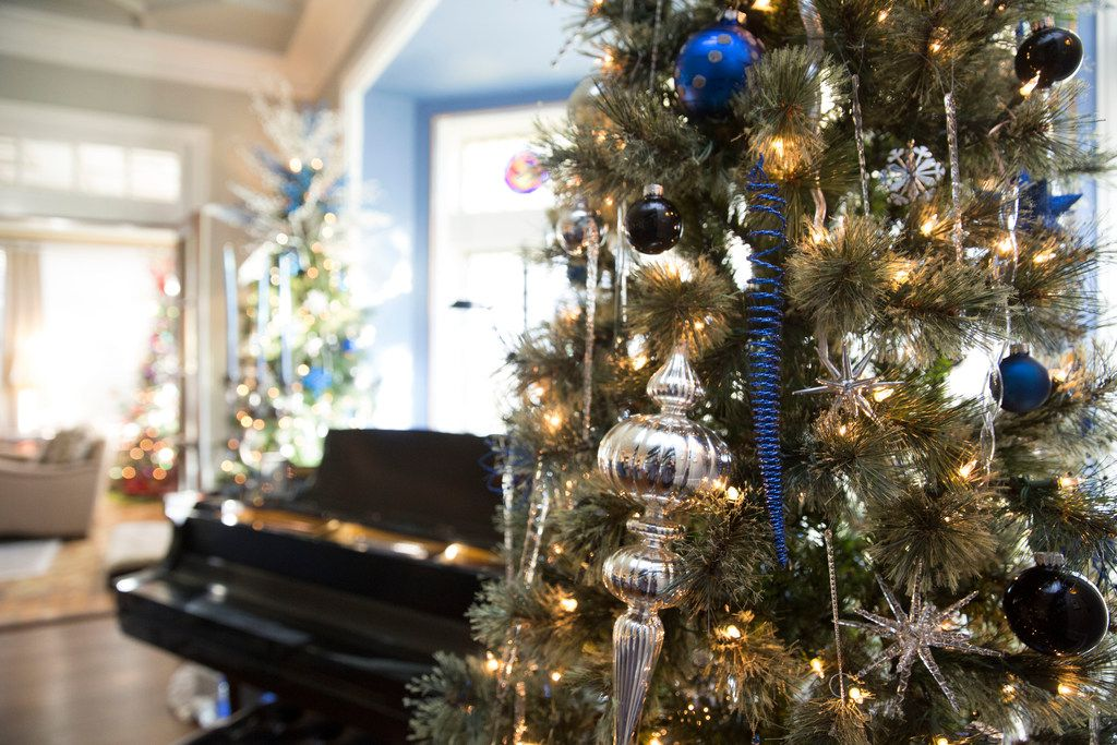 Wayne Noble and Barry Jones have filled their East Dallas home with more than three dozen Christmas trees.