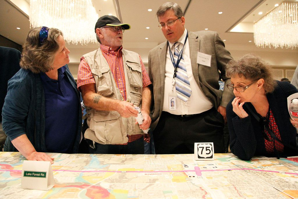 From left: Celeste Harden of McKinney and her husband Clif talk with TxDOT Professional Engineer Jason Estridge while Linda Riggs of McKinney looks on at a public hearing Thursday night. (Stewart F. House/Special Contributor)