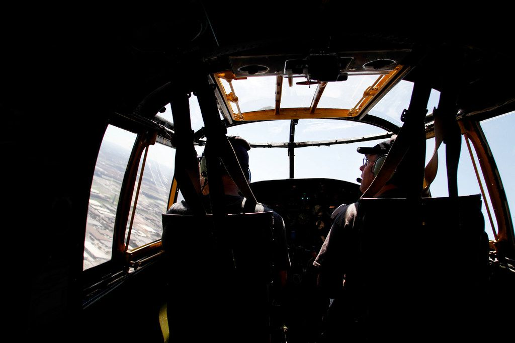 Pilot Will Dismukes (left) and co-pilot Eric Whyte with the Collins Foundation fly a North American B-25 Mitchell Bomber over North Texas as part of their Wings of Freedom Tour on Wednesday, March 13, 2019.
