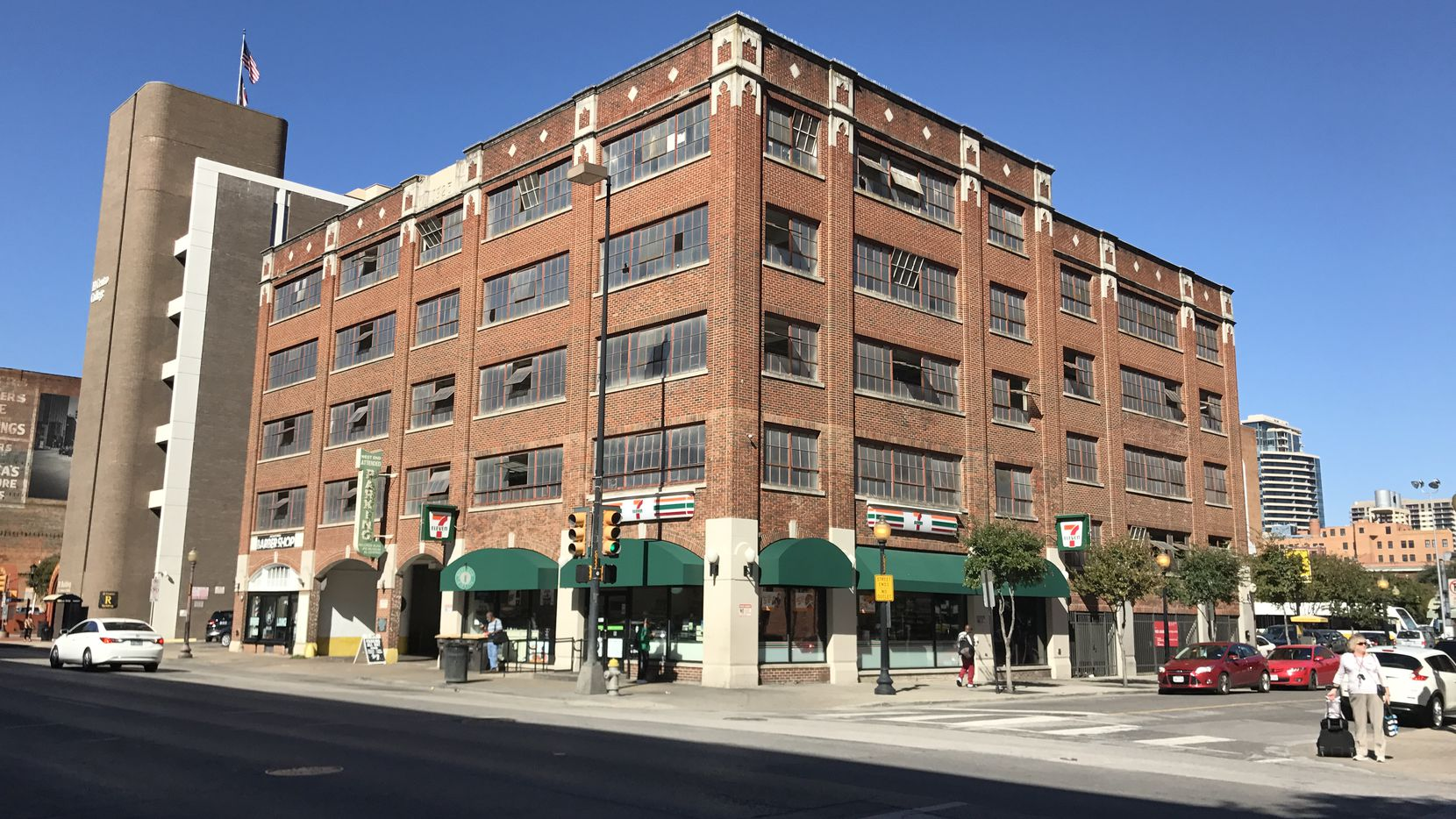 The 711 Elm Street building was constructed as a parking garage in 1925 for the Sanger Brothers department store.