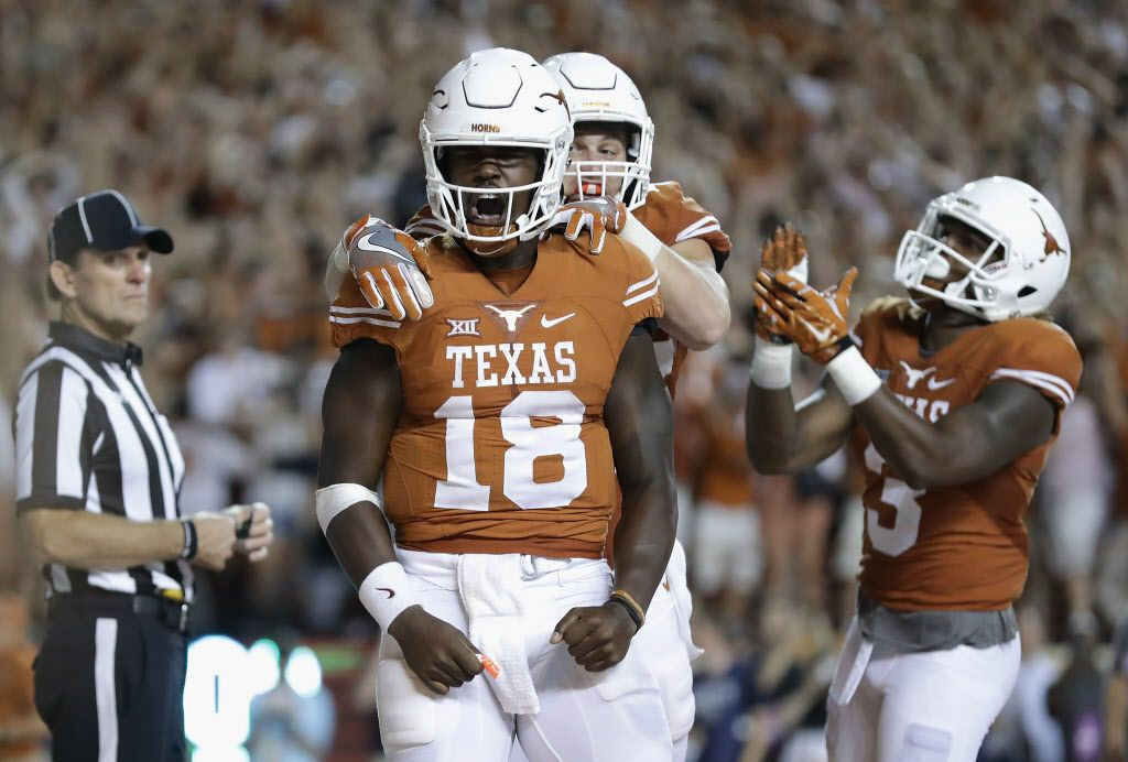 AUSTIN, TX - SEPTEMBER 04:  Tyrone Swoopes #18 of the Texas Longhorns celebrates with teammates after scoring a touchdown in the first overtime against the Notre Dame Fighting Irish at Darrell K. Royal-Texas Memorial Stadium on September 4, 2016 in Austin, Texas.  (Photo by Ronald Martinez/Getty Images)
