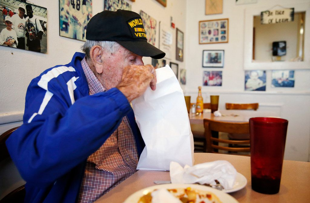 Chester Hollingsworth takes a peek in a bag that the staff at Mama's Daughters' Diner  brought to his table.