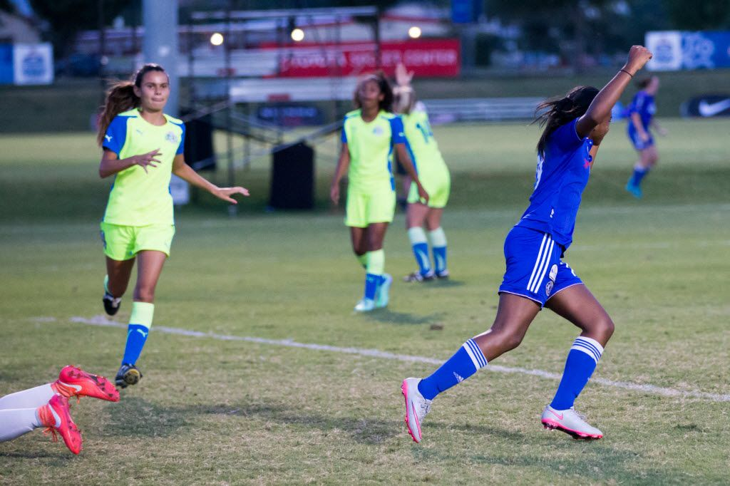 Solar Chelsea Red forward Trinity Byars (right) celebrates after scoring a goal during the U13 girls 2016 US Youth Soccer National Championship game at Toyota Soccer Center on July 30, 2016 in Frisco, Texas. (Ting Shen/The Dallas Morning News)