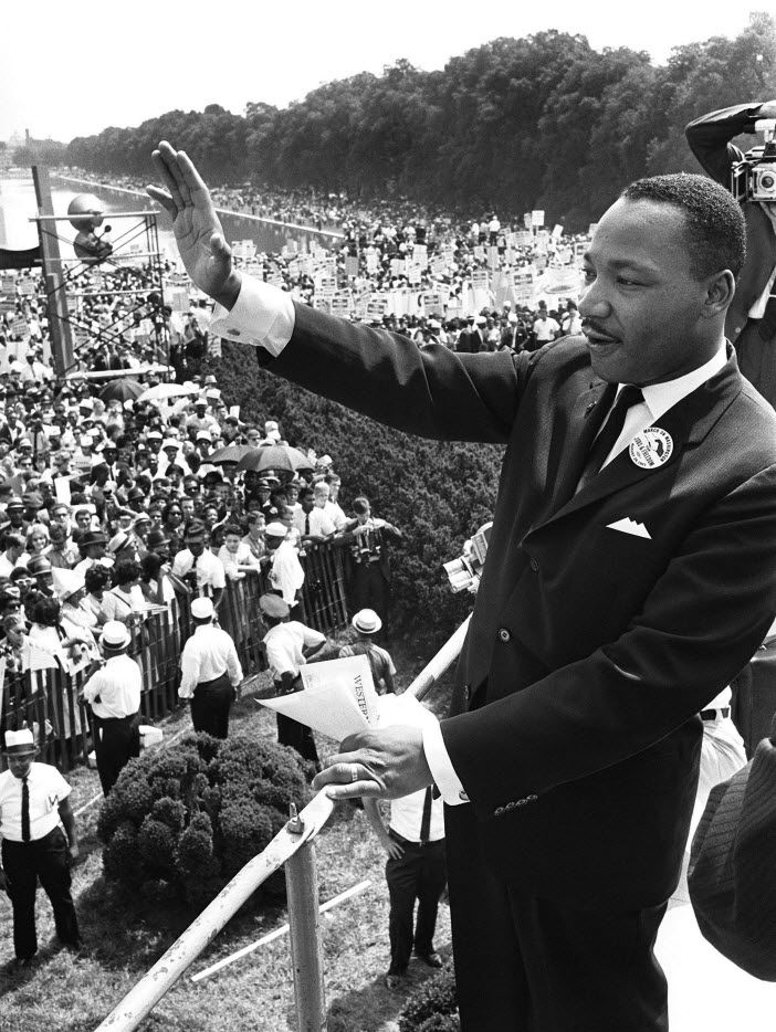 """US civil rights leader Martin Luther King, Jr. waves to supporters in this August 28, 1963, file photo, from the Lincoln Memorial on the Mall in Washington, D.C., during the """"March on Washington."""" (Photo credit: AFP/Getty Images)"""