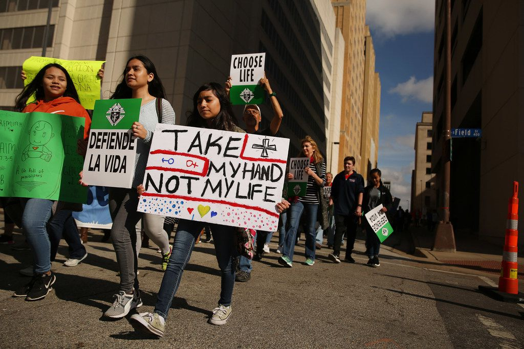 Marchers move through downtown during the North Texas March for Life in Dallas Saturday January 20, 2018. The march started at the Cathedral Shrine of the Virgin of Guadalupe and ended at the Earle Cabell Federal Building. (Andy Jacobsohn/The Dallas Morning News)