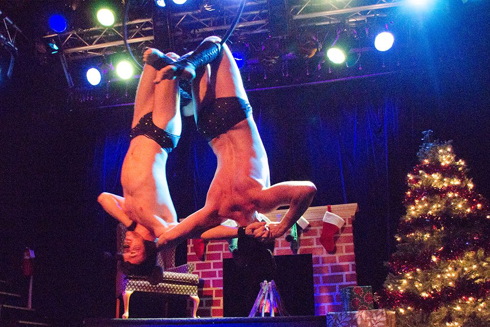 Skye Starling and Icky Muffin swing from the ceiling at the 5th annual Nearly Naked Nutcracker.