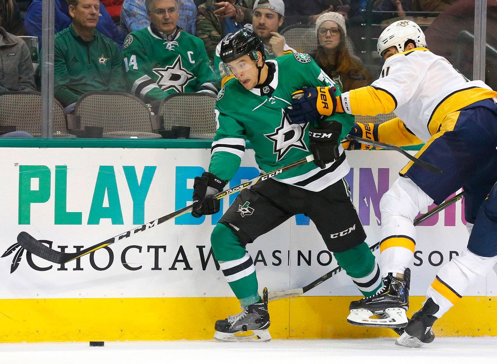 Nashville Predators center Brian Boyle (11) is called for holding on Dallas Stars center Joel L'Esperance (38) during the first period at the American Airlines Center in Dallas, Tuesday, February 19, 2019. (Tom Fox/The Dallas Morning News)