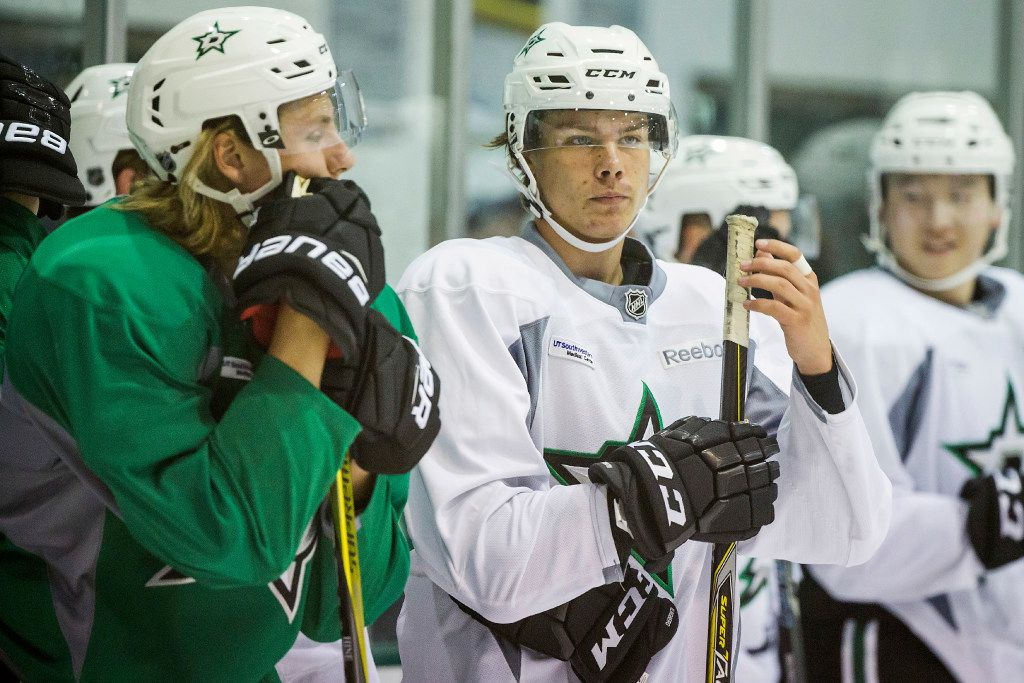 Defenseman Miro Heiskanen (center) and forward Roope Hintz (left) pause between drills on the first day of Dallas Stars development camp at the Dr Pepper StarCenter on Saturday, July 8, 2017, in Frisco. (Smiley N. Pool/The Dallas Morning News)