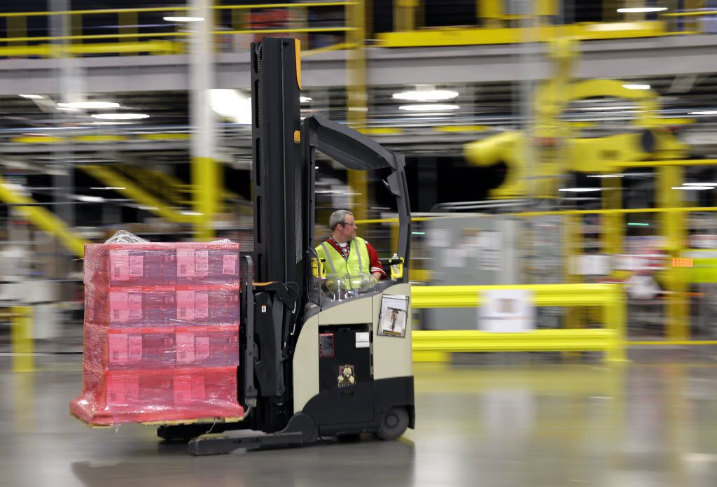 A forklift operator moves a pallet of goods at an Amazon fulfillment center in DuPont, Wash.