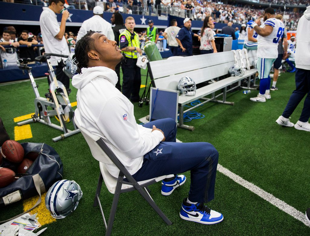 Dallas Cowboys defensive end Taco Charlton (97) sits on the sideline during the first quarter of an NFL game between the New York Giants and Dallas Cowboys on Sunday, September 8, 2019 at AT&T Stadium in Arlington.