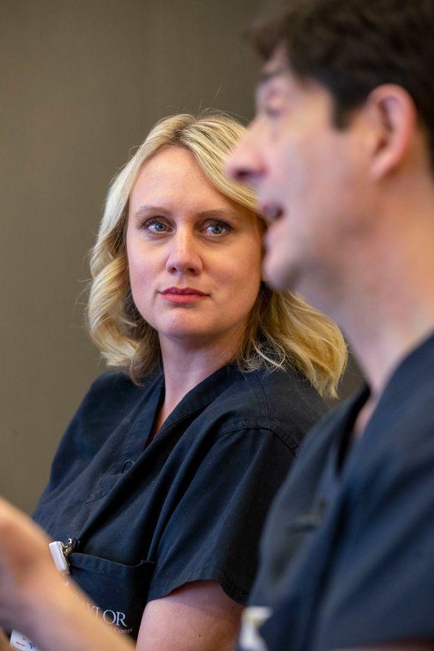 Dr. Liza Johannesson listens as Dr. Giuliano Testa explains the procedure.