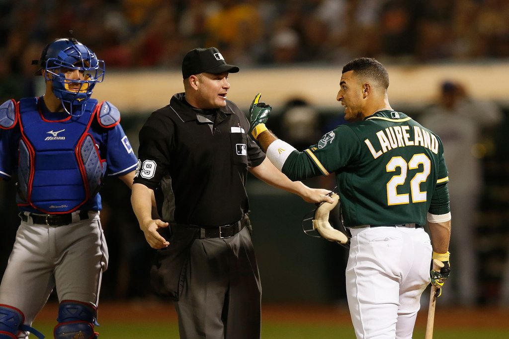 OAKLAND, CALIFORNIA - JULY 27: Ramon Laureano #22 of the Oakland Athletics reacts after being hit by a pitch in the bottom of the eighth inning against the Texas Rangers at Ring Central Coliseum on July 27, 2019 in Oakland, California. (Photo by Lachlan Cunningham/Getty Images)