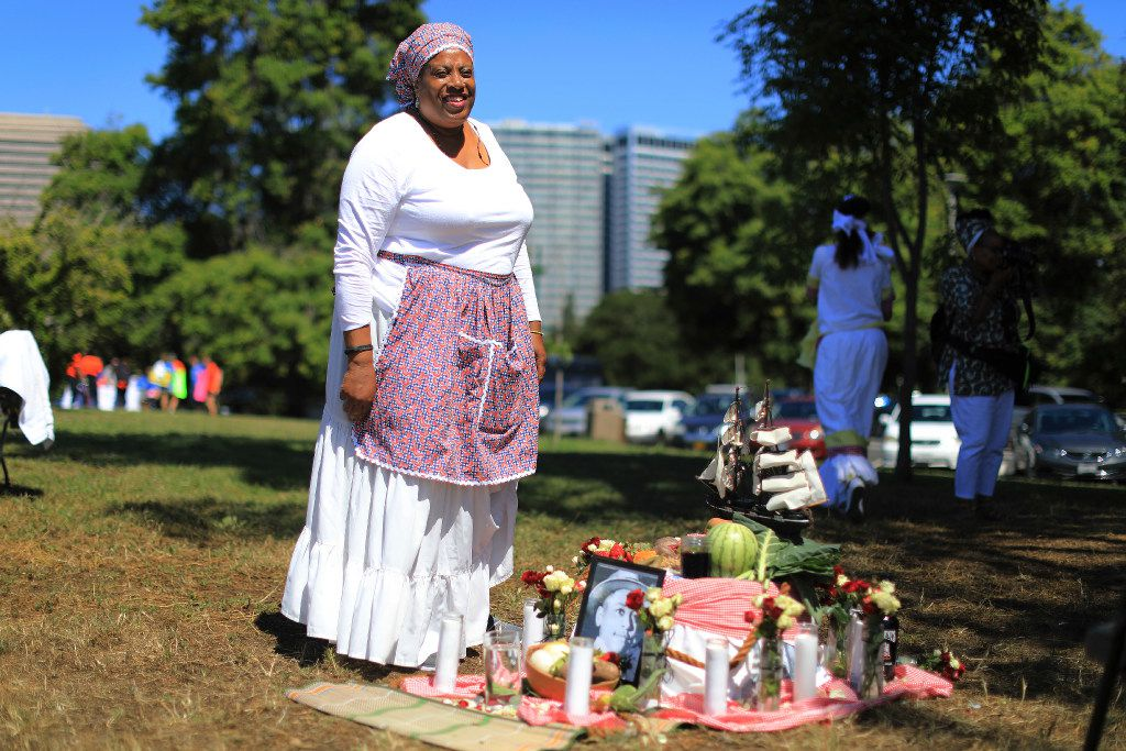 Wanda Blake with an altar of symbolic foods during a Juneteenth Ritual of Remembrance in Oakland, Calif., June 10, 2017. The holiday, which celebrates the abolition of slavery in the United States, is an occasion to gather and eat. (Jim Wilson/The New York Times)