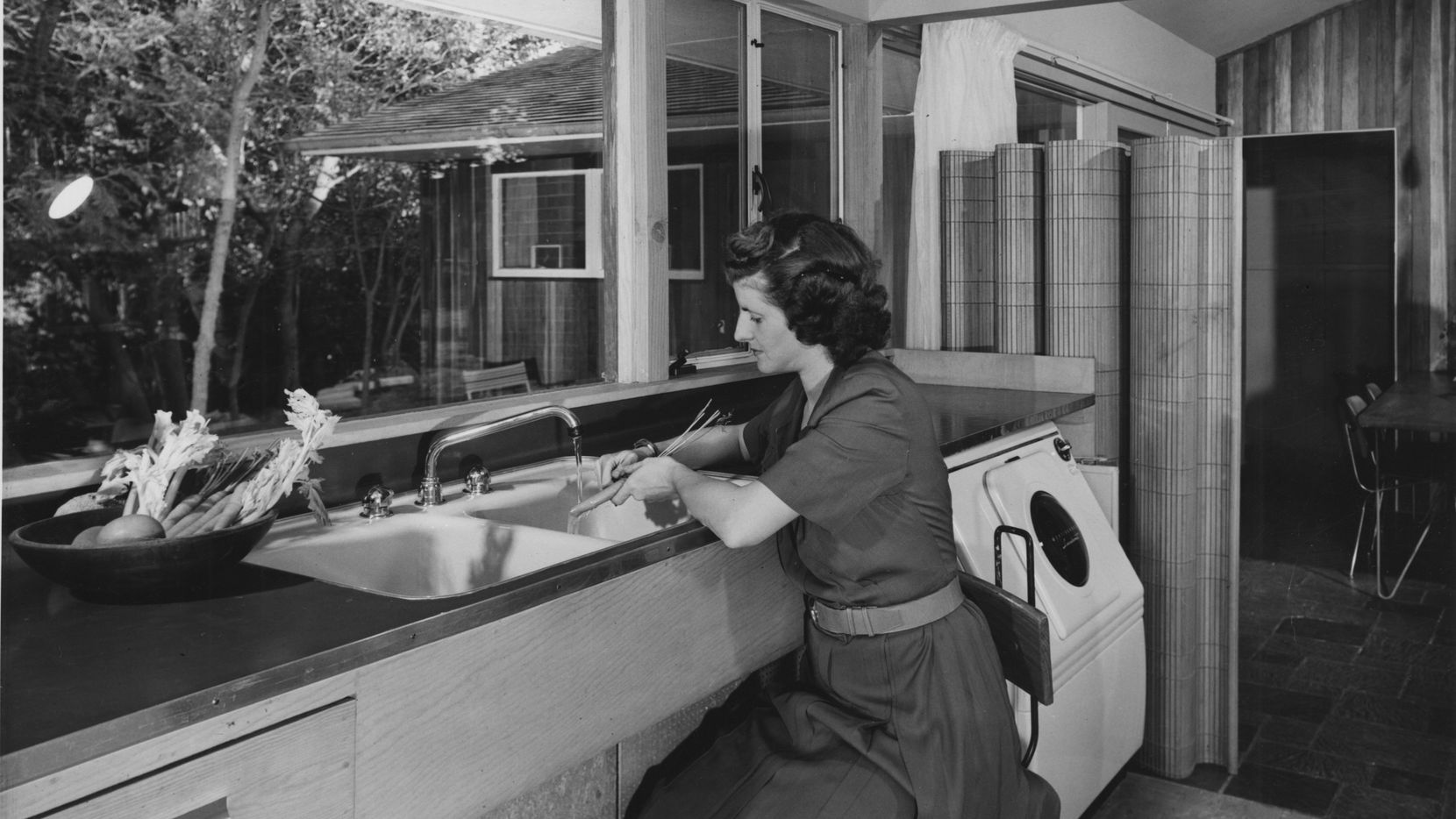 Dallas modernist architect Harold Prinz built this home on Maple Springs Boulevard as his family residence in 1949. His wife, Jeanette Prinz, is shown working in the kitchen.